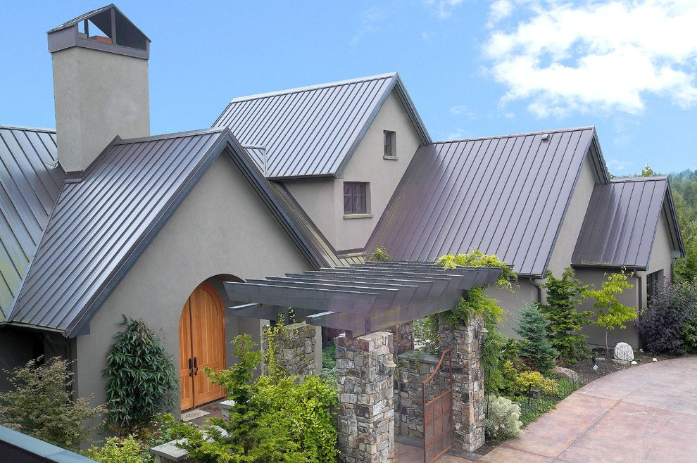 Estes Roofing with Contemporary Exterior and Arched Door Front Entrance Pavers Stone Stucco Tin Roof Trellis
