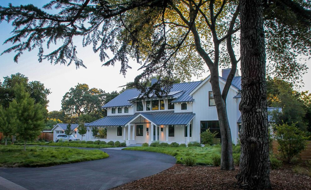 Estes Roofing with Farmhouse Exterior and Asphalt Driveway Circular Driveway Curb Appeal Farmhouse Metal Roof No Mow Lawn Standing Seam Roof White Siding Wrap Around Porch