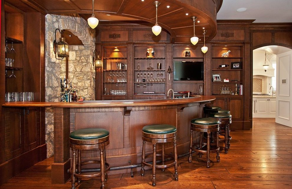 Ethan Allen Bar Stools   Traditional Home Bar Also Built in Shelves Corner Bar Crown Molding Curved Bar Foot Rail Home Bar Lanterns Pendant Lighting Stone Wall Wood Floors Wood Paneling Wood Trim