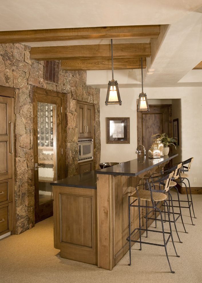 Ethan Allen Bar Stools with Rustic Home Bar  and Bar Earth Tone Colors Exposed Beams Home Bar Lanterns Pendant Lighting Rustic Stone Wall Wicker Barstools Wood Cabinets