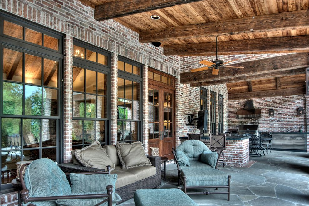 Euro Furniture Chicago   Mediterranean Patio Also Black Window Frames Brick Wall Covered Patio Outdoor Grill Patio Furniture Rafters Sofa Teal Seat Cushions Wood Ceiling Wood Ceiling Fan Wood Door