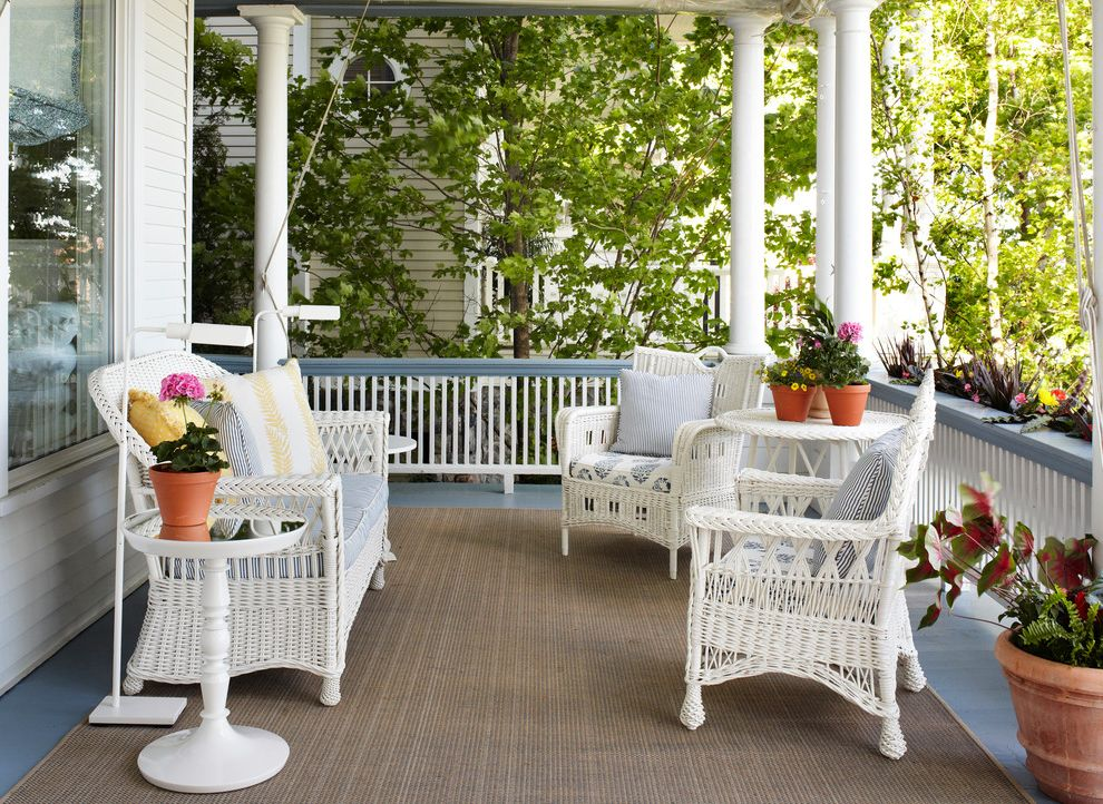 Euro Furniture Chicago with Victorian Porch  and Blue and White Coastal Columns Cottage Floor Lamp Outdoor Rug Potted Plant Railing Shabby Chic Wicker Chair Wicker Furniture Wicker Settee Wicker Table