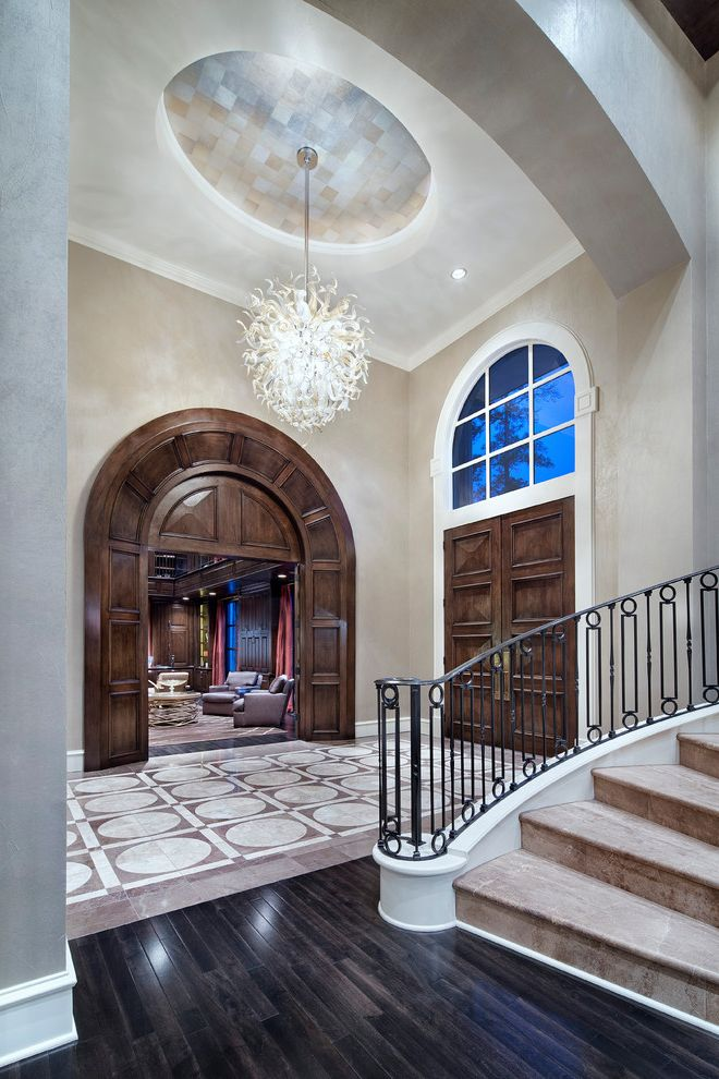 Expensive Chandeliers   Traditional Entry Also Arched Doorway Arched Window Ceiling Pattern Chihuly Double Doors Floor Tile Pattern Glass Chandelier Grand Staircase