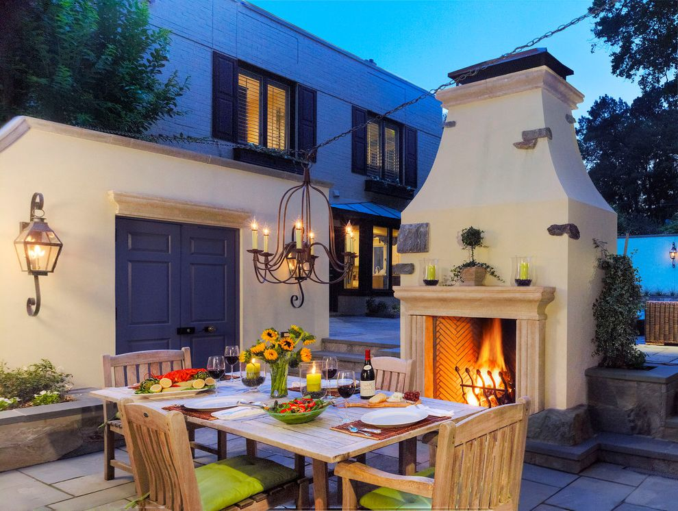 Expensive Chandeliers with Mediterranean Patio Also Alfresco Dining Chandelier Dining Room Duel Sided Fireplace French Outdoor Dining Furniture Outdoor Dining Table Outdoor Fireplace Patio Purple Sunflowers Wall Lanterns Wood Dining Chairs