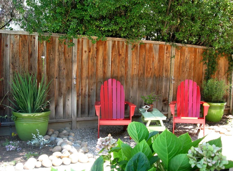 Extra Wide Rocking Chair with Eclectic Landscape Also Adirondack Chair Colorful Container Plants Drought Tolerant Gravel Hydrangeas Low Water Potted Plants Red Chairs Rock Garden Side Yard Makeover Small Outdoor Space Wood Fence