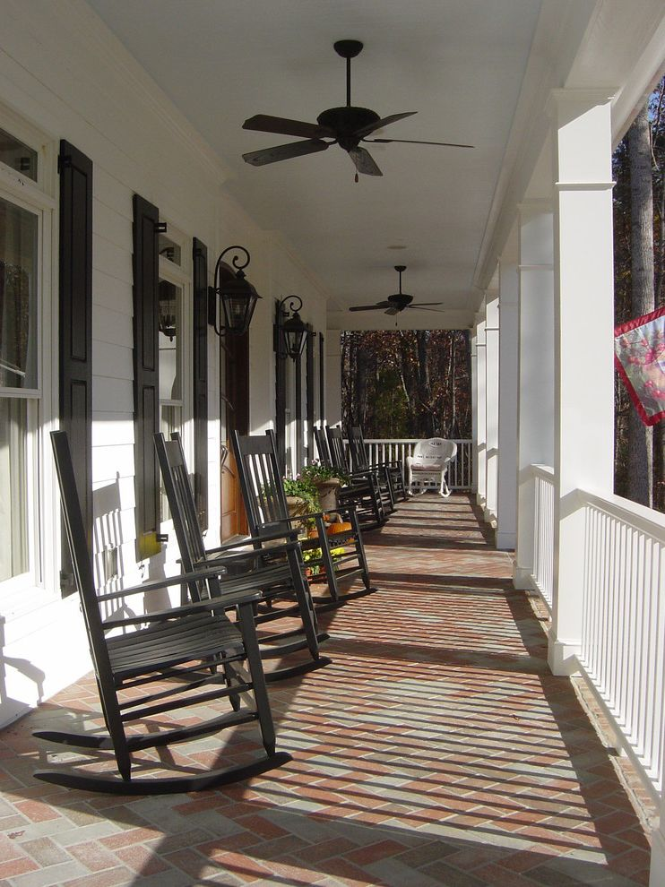 Extra Wide Rocking Chair with Traditional Porch Also Brick Paving Ceiling Fan Davidson Energy Star Entrance Entry Front Porch Herringbone Pattern Lanterns Lap Siding Leed Nc Porch Rockers Rocking Chairs Window Shutters Wood Railing Wood Siding