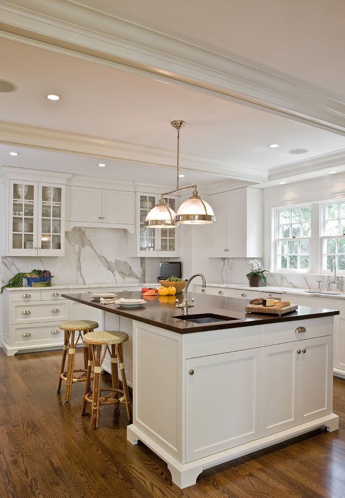 Ezs8wslk with Traditional Kitchen  and Bistro Chairs Breakfast Bar Ceiling Lighting Cottage Eat in Kitchen Exposed Beams Glass Front Cabinets Island Lighting Island with Seating Kitchen Island Recessed Lighting White Kitchen Wood Flooring
