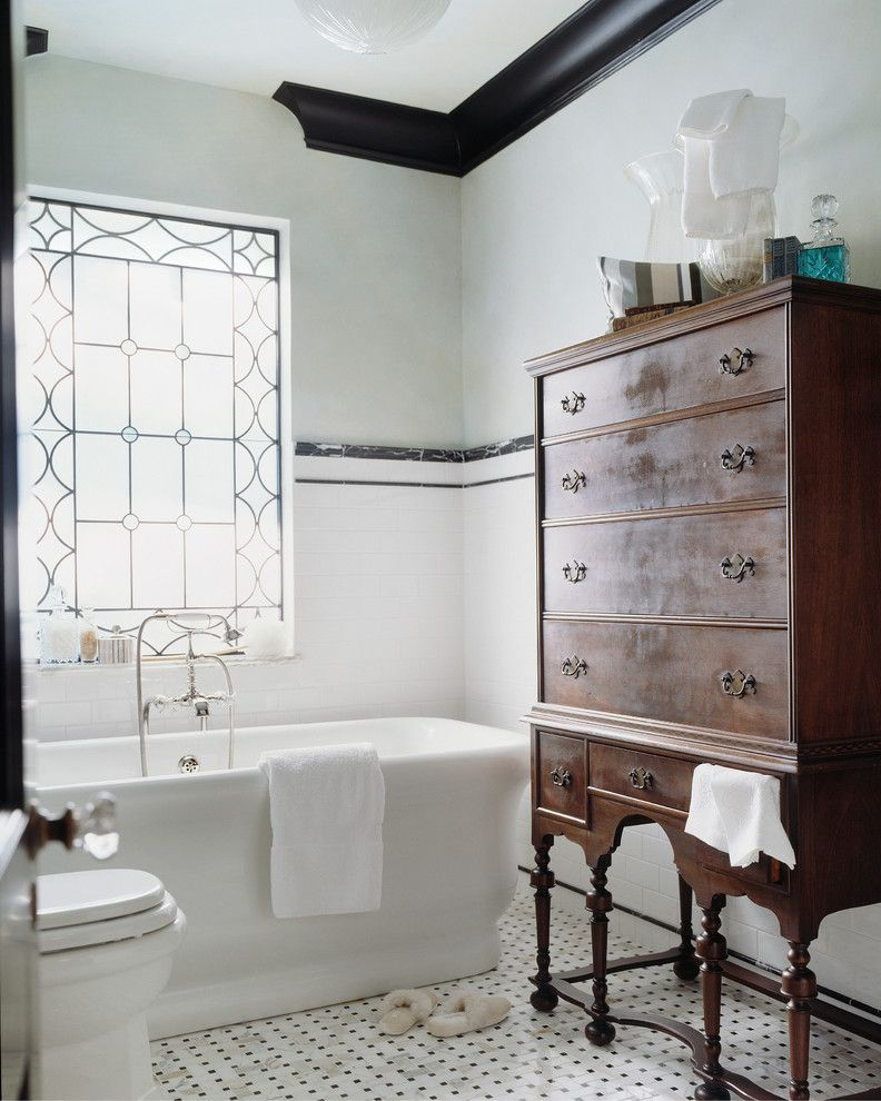 Fairway Com Furniture   Victorian Bathroom  and Accent Window Black and White Floor Black Crown Molding Black Molding Molding Soaker Tub Tiled Wall Tub White Tile Window Wood Cabinet
