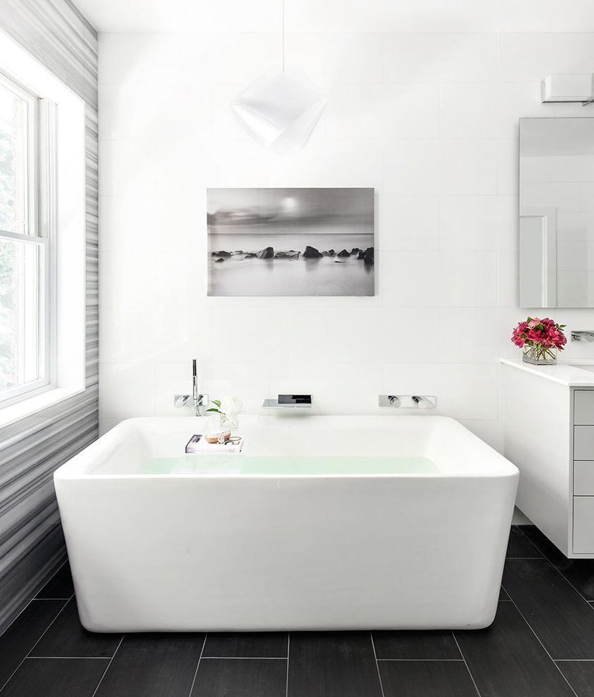 Fantini Faucets   Modern Bathroom Also Black Floor Tile Geometric Pendant Chandelier Horizontal Stripe Walls Wallpaper White Bathroom