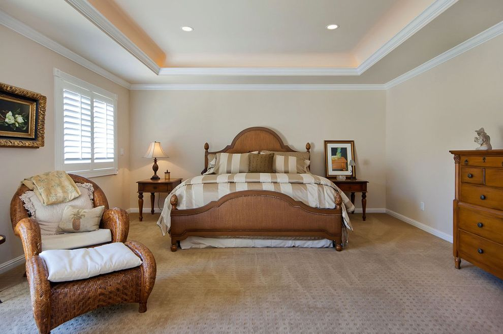 Far Oaks Golf Course with Traditional Bedroom  and Arm Chair Beige Carpeting Cove Lights Dresser Lounge Chair Ottoman Pelmet Lighting Shutter Striped Duvet Tray Ceiling White Painted Trim Wicker