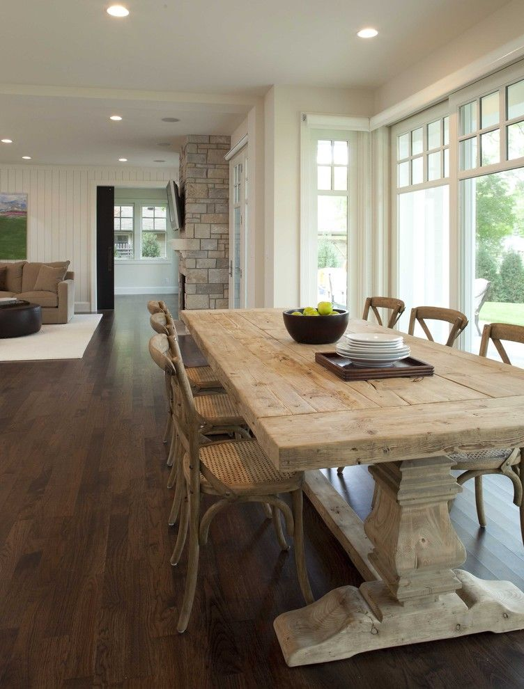 Farm Tables for Sale with Shabby Chic Style Dining Room  and Beadboard Cane Chairs Ceiling Lighting Dark Floor Fruit Bowl Great Room Neutral Colors Open Floor Plan Recessed Lighting Rustic Trestle Table Wood Flooring