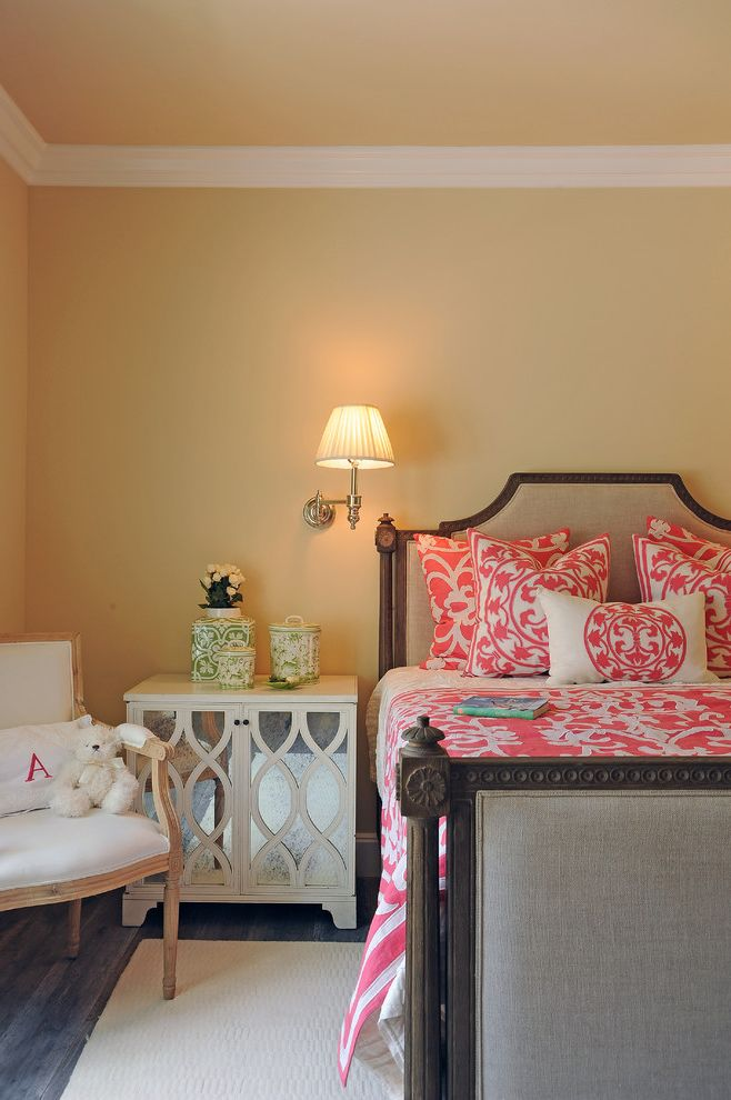 Farmhouse Bedding Sets   Traditional Bedroom  and Beige Bed Beige Rug Beige Wall Bright Bedding Dark Wood Bed Green Accessories Mirrored Nightstand Pink Bedding Rustic Wood Floor Teddy Bear Wall Sconce White Armchair White Molding