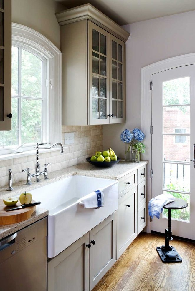 Farmhouse Sink Sizes   Traditional Kitchen  and Arched Door Arched Window Chrome Faucet Cottage Farmhouse Kitchen Farmhouse Sink Faucet French Door Glass Cabinet Stone Countertop Stool Subway Tile Wood Floor