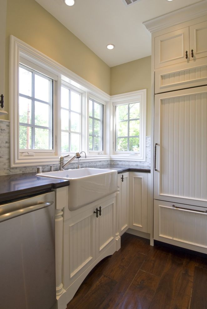 Farmhouse Sink Sizes with Traditional Kitchen  and Beadboard Cabinet Front Fridge Farmhouse Sink Hardwood Floors Marble Tile Backsplash Panel Refrigerator Stainless Steel Appliances White Cabinets