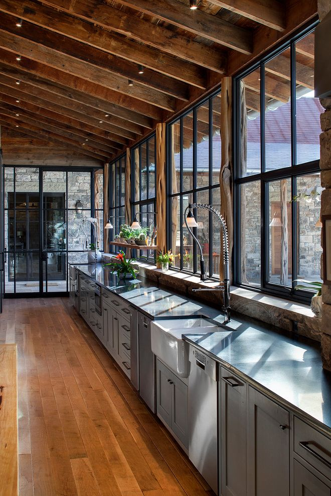 Faucets Galore   Rustic Kitchen  and Exposed Wood Beams Ranch Rustic Modern Rustic Wood Steel Door Steel Window Window Wall Windows Wood Floors