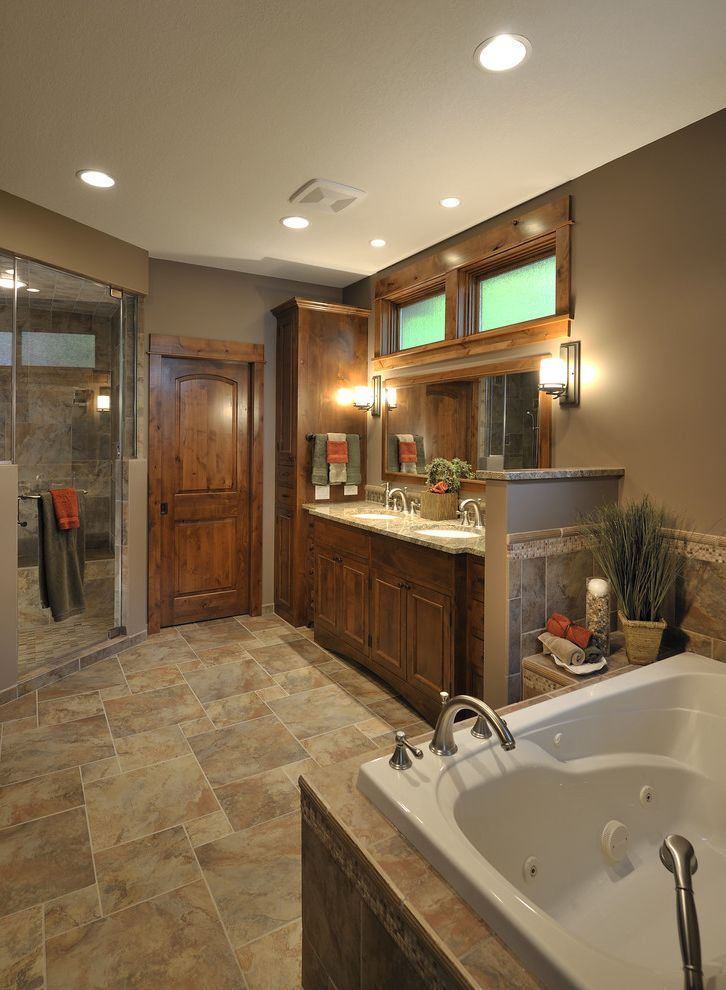 Faucets Galore with Traditional Bathroom Also Beige Double Sink Glass Shower Enclosure Jetted Tub Soaking Tub Tile Floor Vanity Wall Sconce Wood Trim