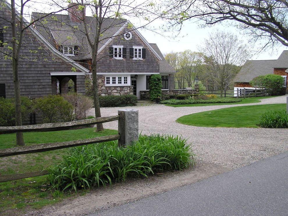 Fence Companies in Delaware with Farmhouse Exterior  and Cape Cod Style Circular Driveway Dormer Windows Entrance Entry Grass Gravel Driveway Lawn Rustic Shingle Siding Split Rail Fence Turf White Wood Window Shutters Wood Fencing Wood Trim