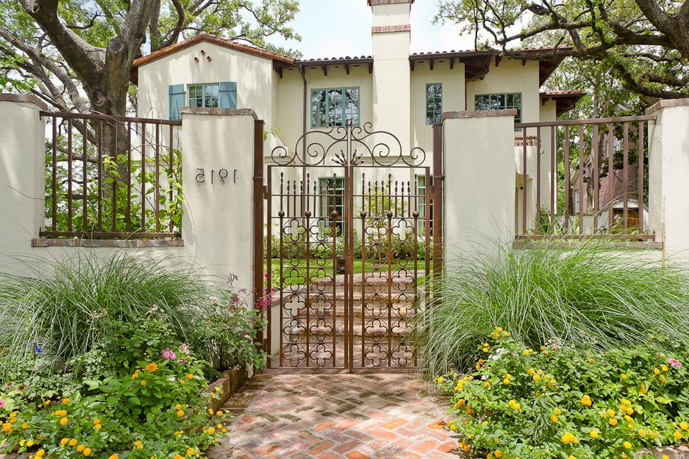 Fence Companies St Louis   Mediterranean Landscape  and Clay Tile Roof English Garden Grasses Iron Gate Quatrefoil Spanish Colonial White Siding Yellow Flowers