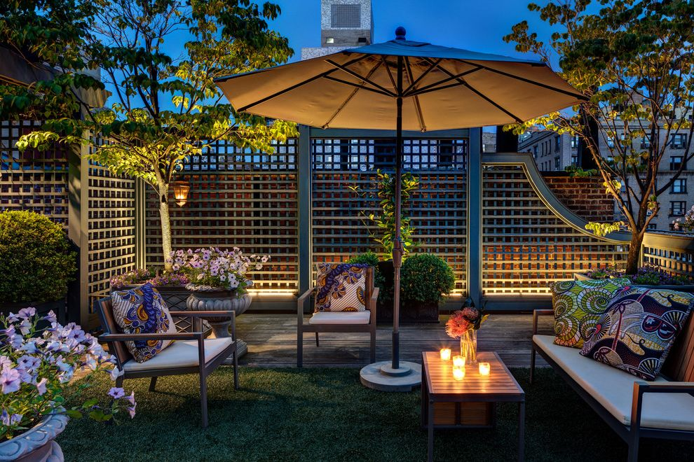 Fence Company Charleston Sc   Traditional Deck Also City Roof Deck Garden Lighting Lattice Fence Night Roof Ladscape Outdoor Lighting Roof Terrace Umbrella White Cabinetry