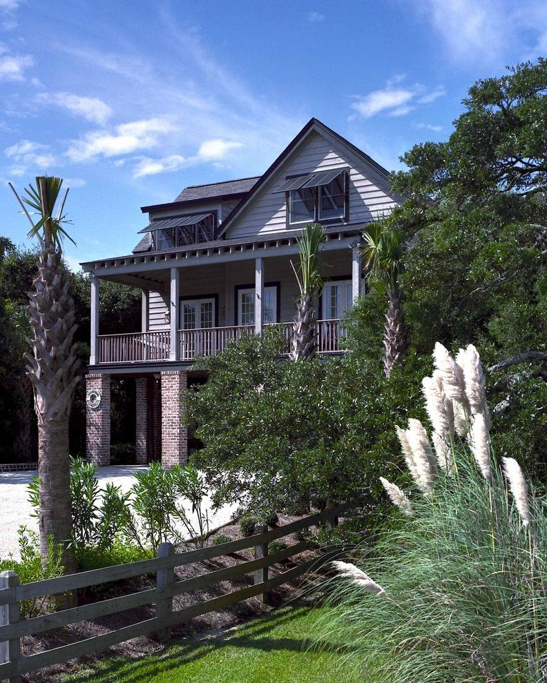 Fence Company Charleston Sc with Beach Style Exterior Also Awnings Balcony Brick Wall Dormer Windows Eaves Grass Lawn Overhang Palm Trees Pampas Grass Porch Split Rail Fence Turf Window Treatments Wood Fencing Wood Siding