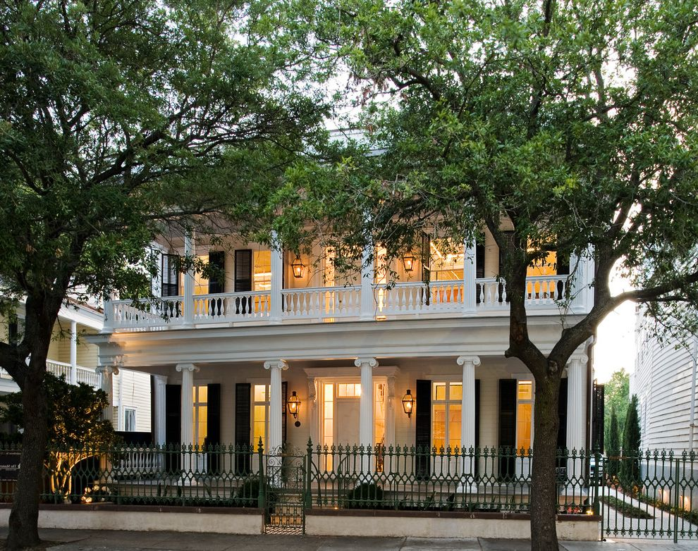 Fence Company Charleston Sc with Traditional Exterior  and Balcony Balustrade Columns Garden Lighting Grass Driveway Ionic Columns Metal Fence Metal Gate Porch Ribbon Driveway Sconce Street Trees Transom Window Window Shutters