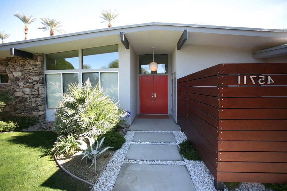 Fence Repair Denver   Modern Entry  and Concrete Stepping Stones Covered Entry Dark Stained Wood Slats Gravel Lawn Pendant Light Rafters Red Double Doors Stone Facade Stones Vaulted Ceiling
