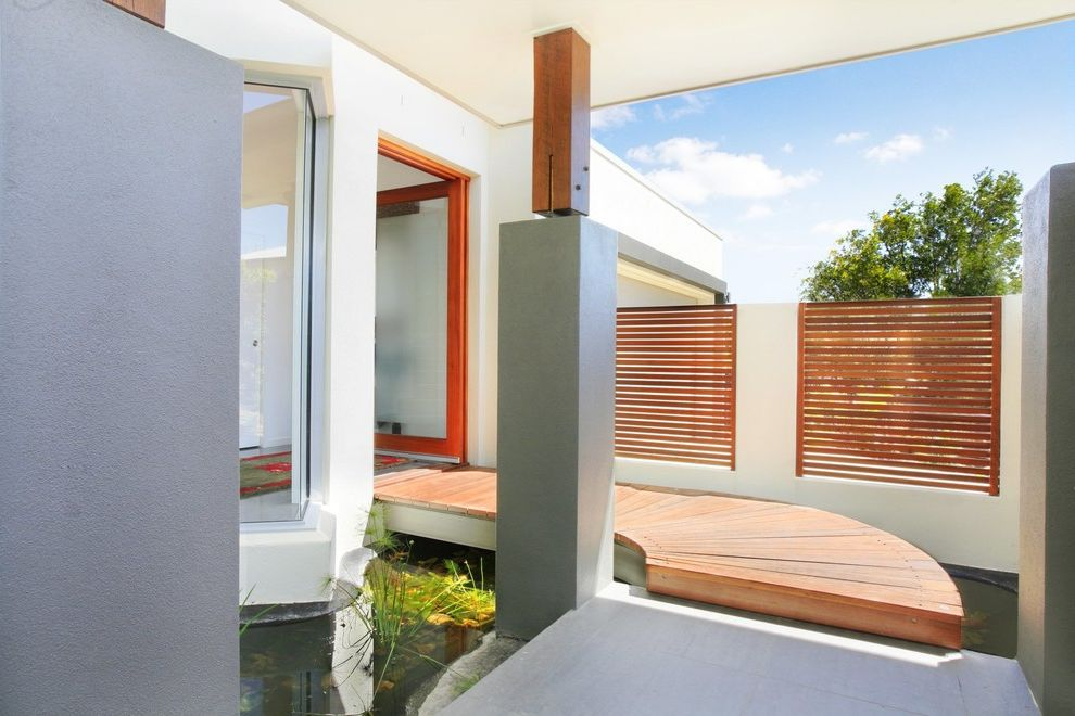 Feng Shui Melrose   Contemporary Entry Also Aquatic Column Covered Entry Curved Walkway Deck Floor Doorway Fence Fountain Glass Door Pond Stucco Water Feature Window Wood Slats
