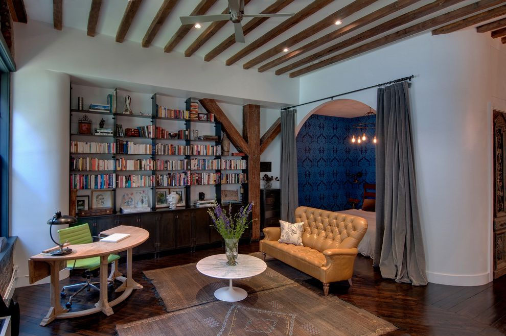 Feng Shui Melrose   Industrial Home Office  and Bedroom Blue Wallpaper Curved Desk Curved Walls Eclectic Exposed Beams Feng Shui Flatweave Area Rug Industrial Loft Metal Bookcase Renovation Rounded Corner Rounded Walls Sleeping Alcove