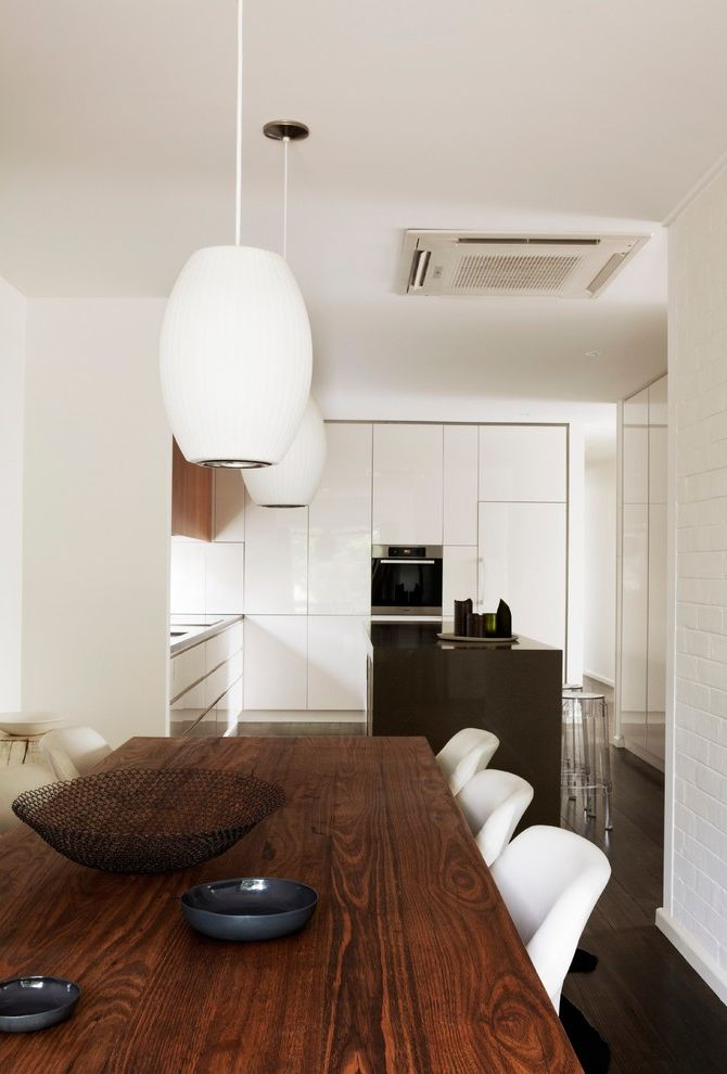 Feng Shui Melrose   Midcentury Dining Room Also Aura Home Australia Dining Chairs Dining Table Gray and White Light Pendants Melbourne Midcentury Modern Pendant Lighting Tracie Ellis Walnut Walnut Cabinets White Brick White Cabinetry