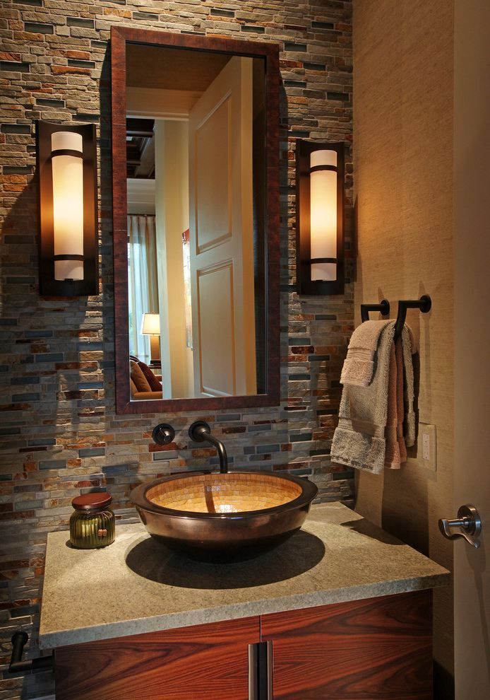 Ferguson Plumbing Orlando   Transitional Powder Room  and Accent Wall Beige Walls Gray Countertop Rectangular Mirror Towel Bar Wall Mounted Faucet Wall Sconces Wood Framed Mirror