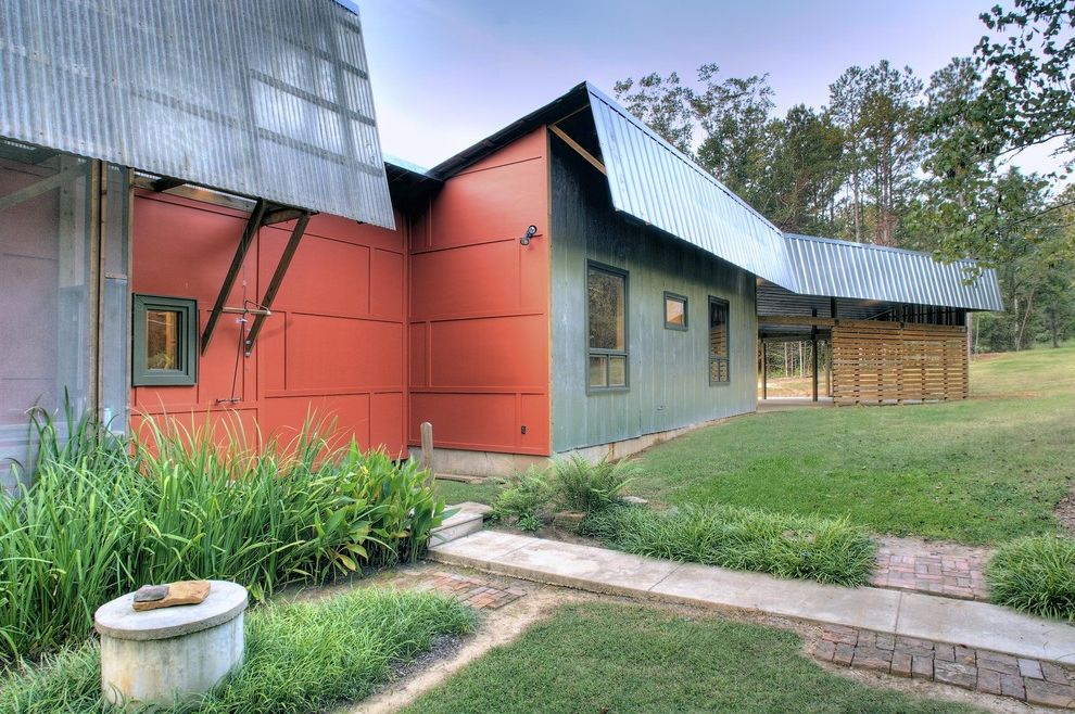 Fiber Cement Siding Options   Industrial Exterior Also Corrugated Roof Entrance Entry Geometric Geometry Grass Green Wall Horizontal Slat Fence Lawn Metal Roof Overhang Path Red Wall Roofline Turf Walkway