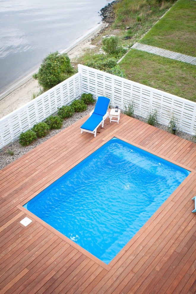 Fiberglass Pools for Sale with Traditional Pool  and Beach House Deck Fence Gravel Landscape Rectangular Pool White Fence Wood Deck