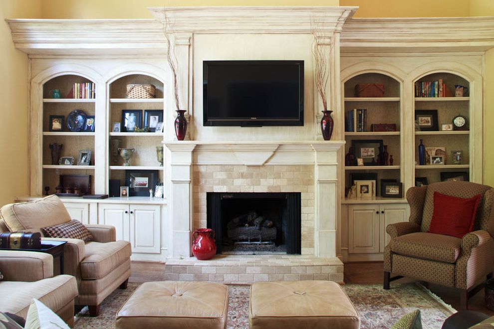 Fireplace Facing Kits   Traditional Family Room  and Area Rug Bookcase Bookshelves Built Ins Fireplace Hearth Fireplace Mantel Leather Cubes Neutral Colors Oriental Rug Shelving Stone Fireplace Surround Storage Tv Above Fireplace Vases Wingback Chair