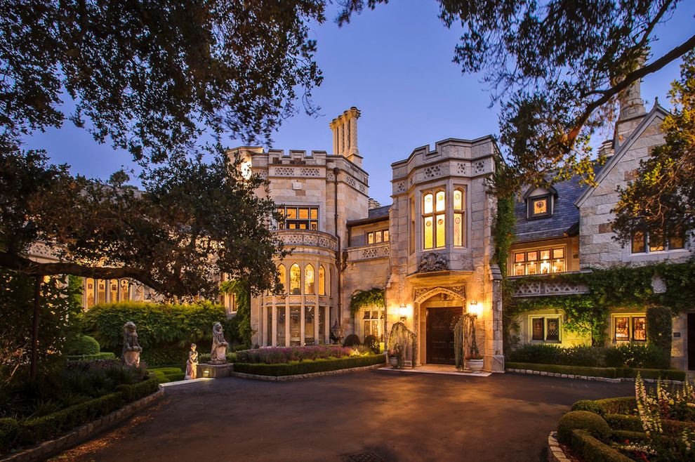 First Castle Homes   Mediterranean Exterior Also Arched Windows Castle Chiltern Estate Chimney Dennis Mayer Driveway Gothic Grand Hedge Hillsborough Night Lighting Parapet Statue Stone House