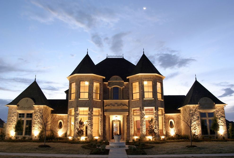 First Castle Homes   Traditional Exterior  and Entrance Entry Fountain Front Door Grass Lawn Night Roof Line Roof Spike Sidewalk Stone Facade Stone House Tower Turf Turret Water Feature