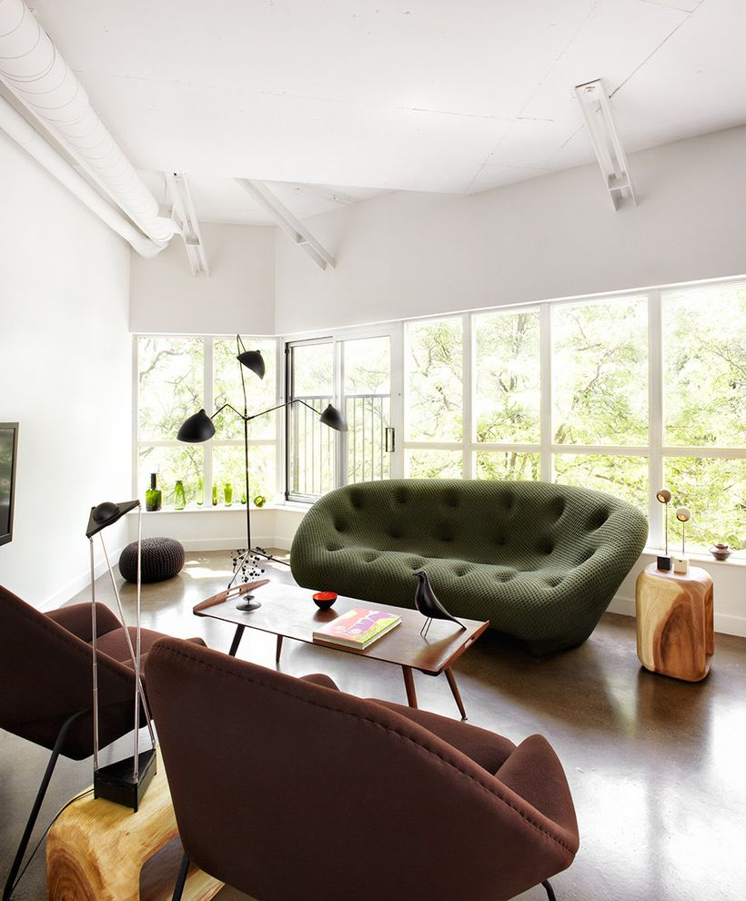 Fischer Homes Careers   Contemporary Living Room Also Bachelor Pad Brown Armchair Green Sofa Loft Wall of Windows Wood Side Table