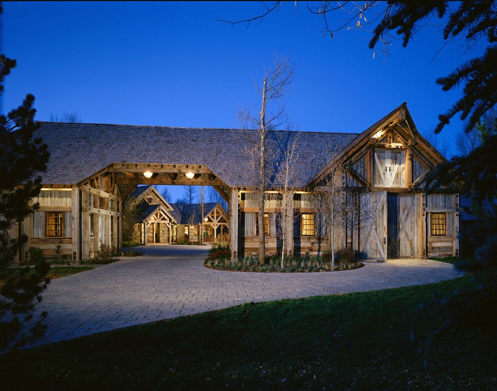 Fischer Homes Careers   Rustic Exterior Also Barn Door Batten Doors Contemporary Mountain Home Portico Rough Hewn Wood Structural Beams Truss Updated Mountain Home Weathered Wood