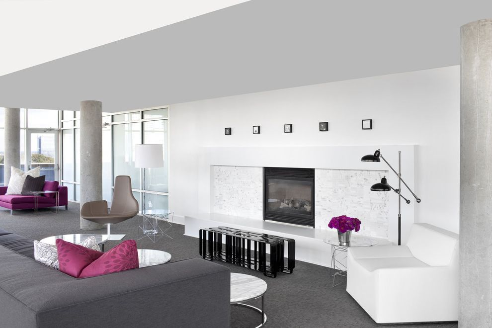 Fjord Chairs with Contemporary Living Room Also Bench Concrete Columns Frosted Glass Windows Gray Carpet Gray Sofa Gray Swivel Chair Marble Coffee Table Marble Fireplace Surround Open Floor Plan Purple Round Coffee Table White Armchair White Walls