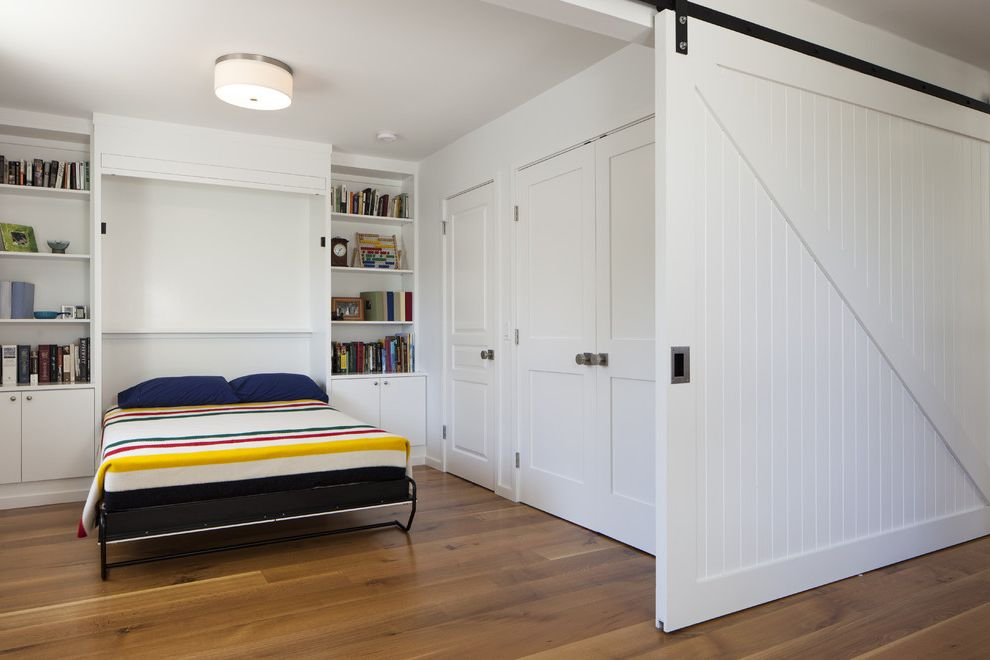 Flex Belt Reviews with Contemporary Bedroom  and Built in Bookshelf Built in Cabinets Drum Ceiling Light Guest Room Murphy Bed Sliding Barn Door Striped Bedding White Barn Door White Door White Wall Wood Floor