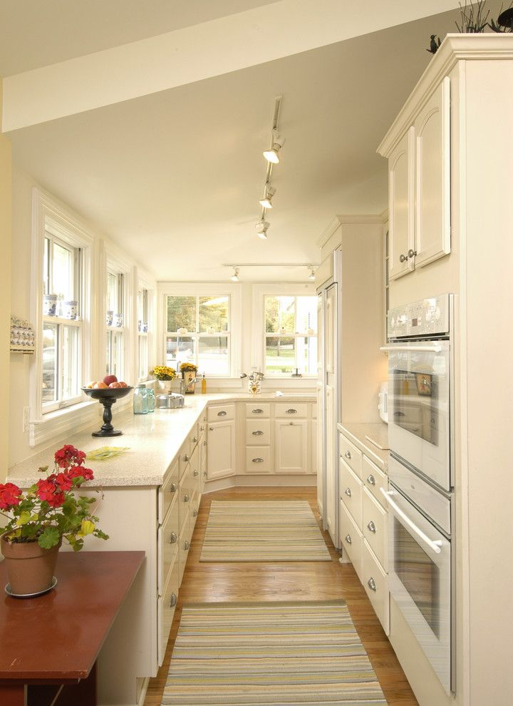 Flexible Track Lighting Kits   Traditional Kitchen Also Double Oven Flowers Integrated Refrigerator Light Wood Floor Striped Area Rug Track Lighting White Appliances White Cabinets White Countertops White Kitchen Window Ledge Wood Side Table