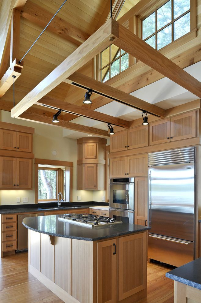 Flexible Track Lighting Kits with Rustic Kitchen Also Dark Counter Exposed Rafters Floor to Ceiling Cabinets High Angled Ceiling Island Light Wood San Juan Islands Shaker Door Soffit Stainless Steel Appliances Suspended Beams Track Lighting Waterfront