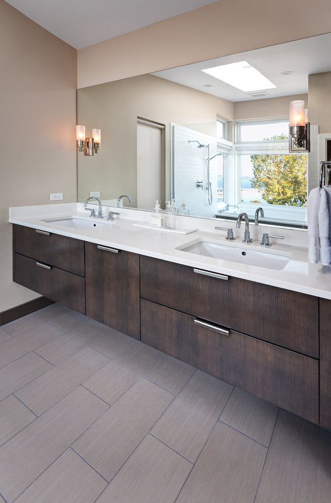 Floating Floor Lowes with Transitional Bathroom Also Brown Baseboard Chrome Hardware Double Sinks Floating Vanity Khaki Wall Mirror Neutral Colors Rectangular Sinks Sconce Tile Floor Towel Bar Undermount Sinks Vanity Storage