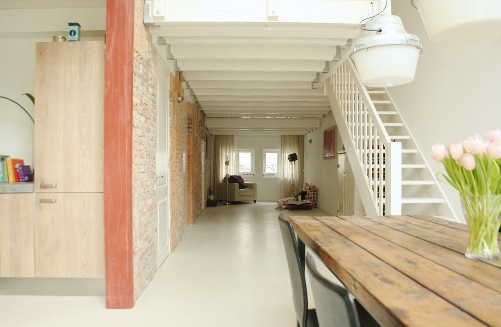 Floor Paint Lowes   Industrial Living Room Also Exposed Brick Flat Panel Cabinets Loft Open Tread Staircase Pendant Lights Salvaged Wood Tulips White Floor Wood Beams Wood Grain