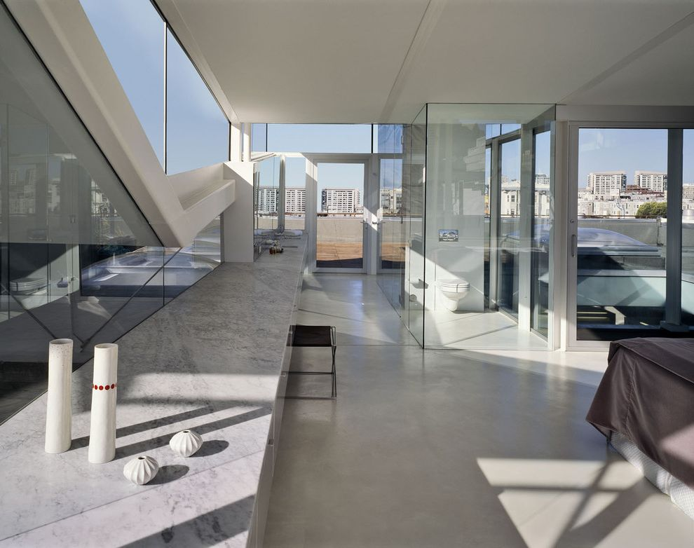 Flooring Over Concrete Options   Industrial Bathroom Also Concrete Floor Floor to Ceiling Windows Glass Partition Glass Wall Marble Countertop Modern Urban