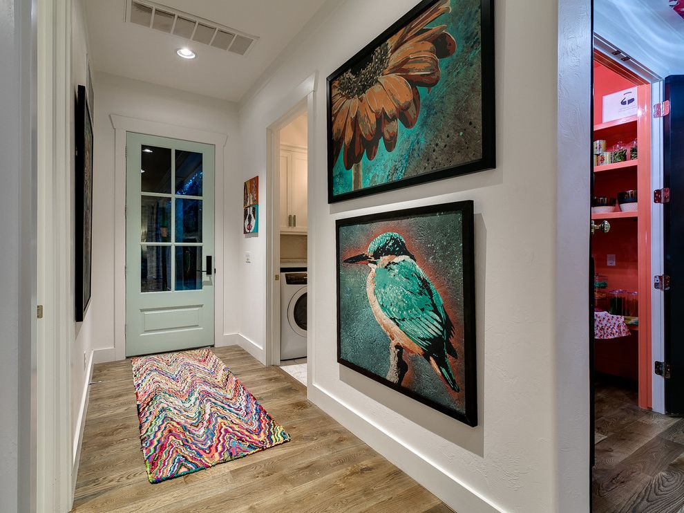 Florists in Edmond Ok with Beach Style Entry and Bird Wall Art Colorful Rug Contemporary Light Wood Floors Mint Green Accents Mint Green Door Modern Beach House Sunflower Wall Art Transitional White Walls