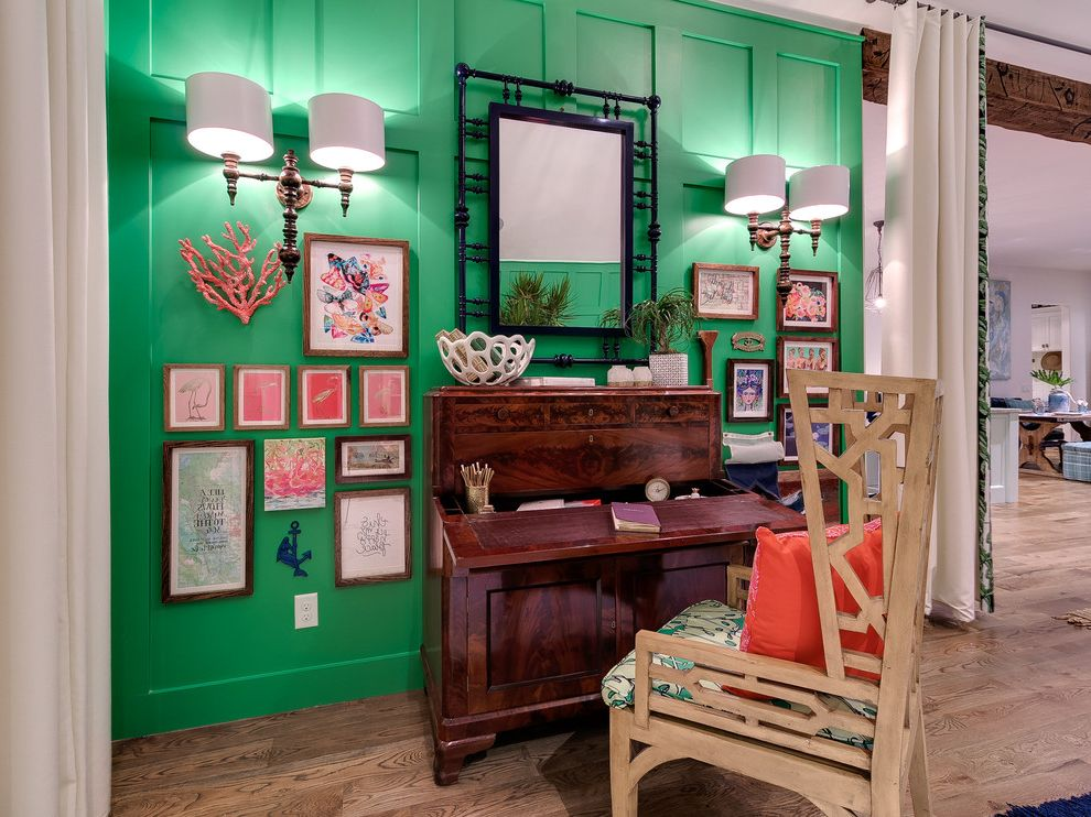 Florists in Edmond Ok with Beach Style Home Office and Artists Studio Black Framed Mirror Coral Accents Framed Art Gallery Wall Green Walls Kelly Green Walls Orange Pillow Tropical Wall Sconce Wood Chair