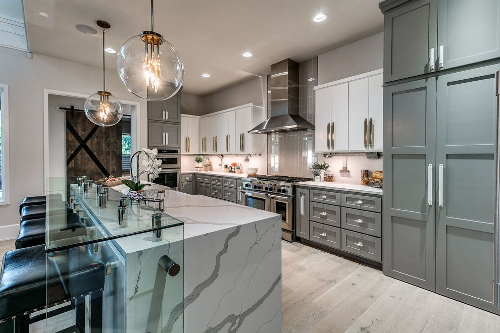 Florists in Edmond Ok with Transitional Kitchen and Bar Stools Breakfast Bar Full Wall Backsplash Glass Counter Top Pendant Lights Waterfall Counter Top White and Gray White and Grey