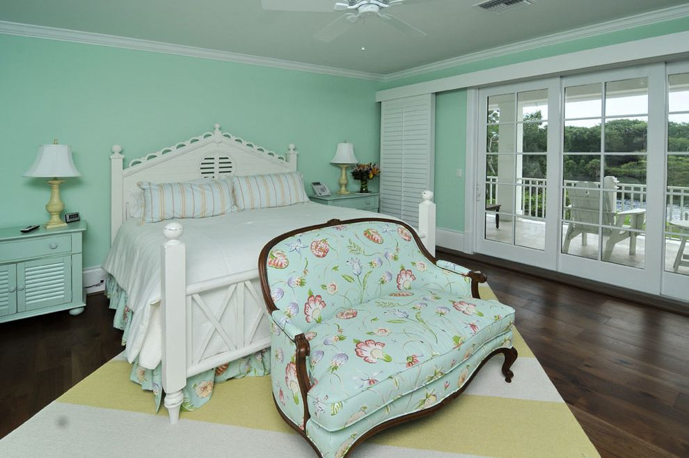 Flowered Sofas with Traditional Bedroom Also Balcony Baseboard Casing and Crown Molding Ceiling Fan Crown Molding Flower Pattern Sofa Chair Mint Green Nightstand Mint Green Wall White Bed White Trim Wood Floor