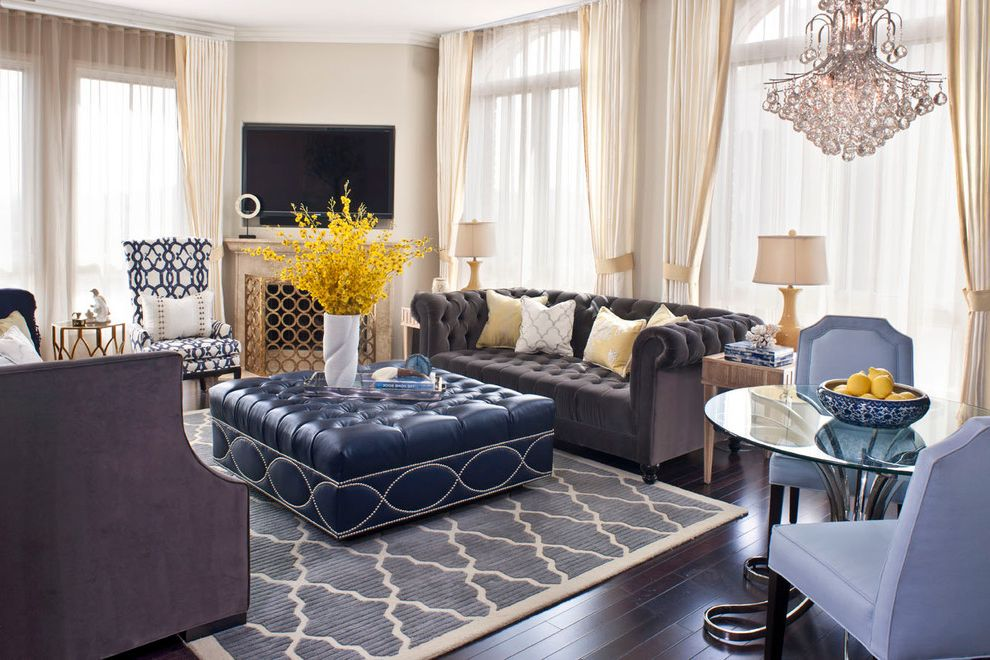 Flowered Sofas with Transitional Living Room  and Blue Dining Chairs Blue Ottoman Ceramic Lamps Chesterfield Sofa Chrome Table Base Cream Drapes Crystal Chandelier Glass Table Gray Sofa Lavender Leather Ottoman Sheers Transitional Trellis Tufted