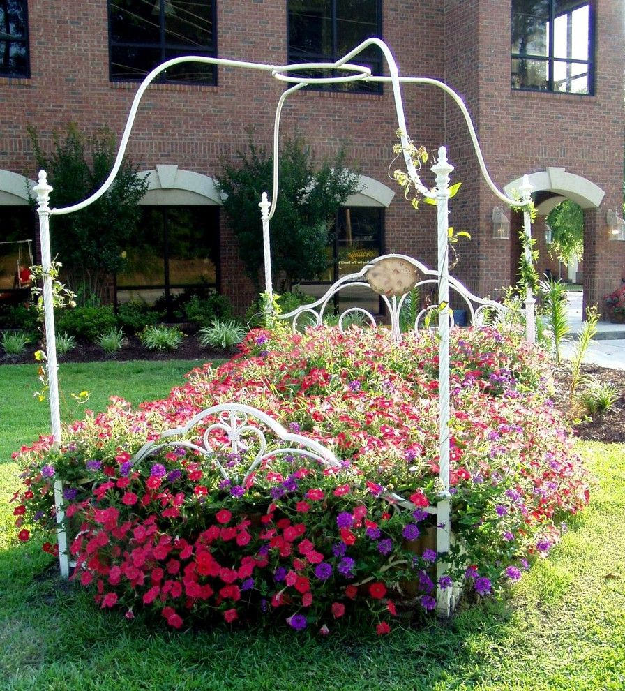 Flowers That Start with a   Eclectic Landscape Also Bed of Flowers Flower Bed Garden Statue Grass Iron Bed Lawn Perennial Pink Planter Planting Purple Sleeping Porch Turf